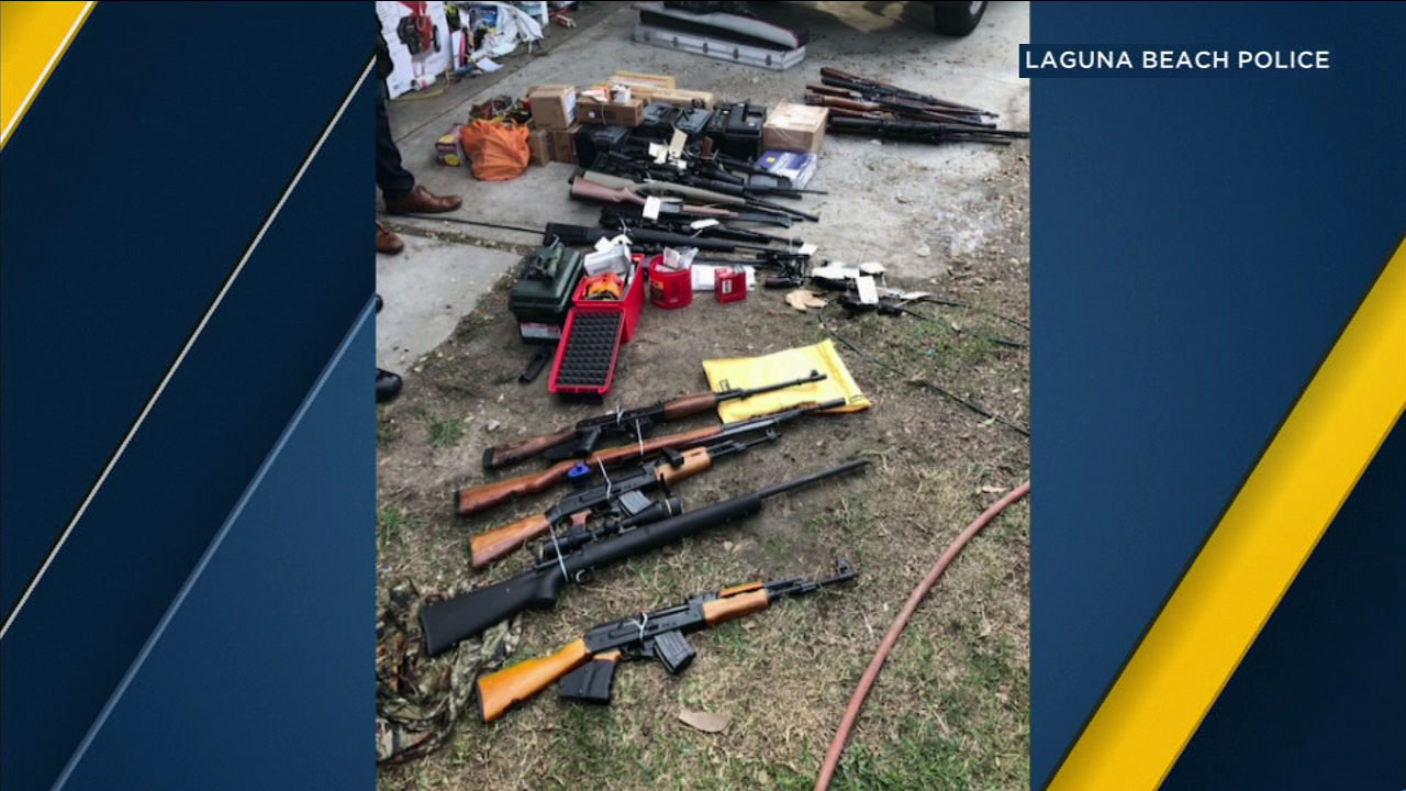 More than 50 weapons were discovered at a home in Huntington Beach, where a 51-year-old man was arrested, police said.