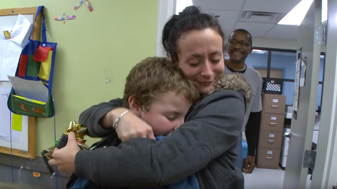 A child hugs his mother after giving her a Christmas gift at the Boys and Girls Club of Metro Atlanta.