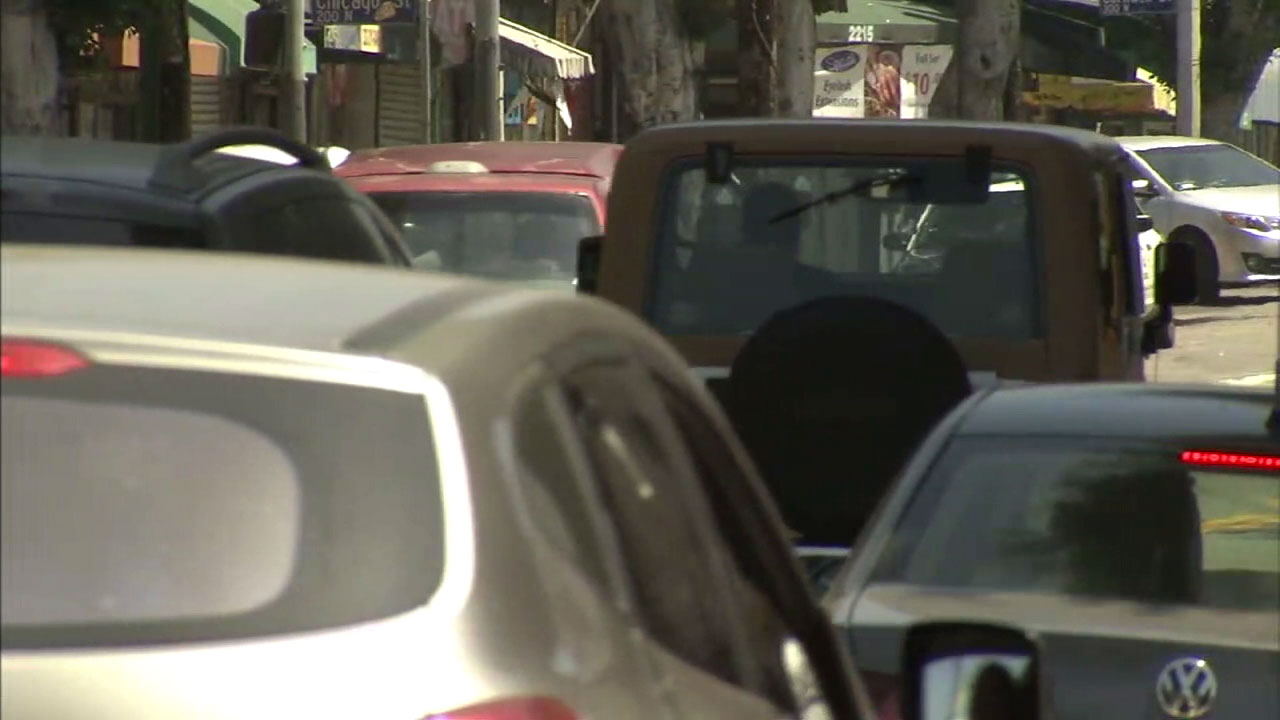 People are shown driving through the streets of Los Angeles.