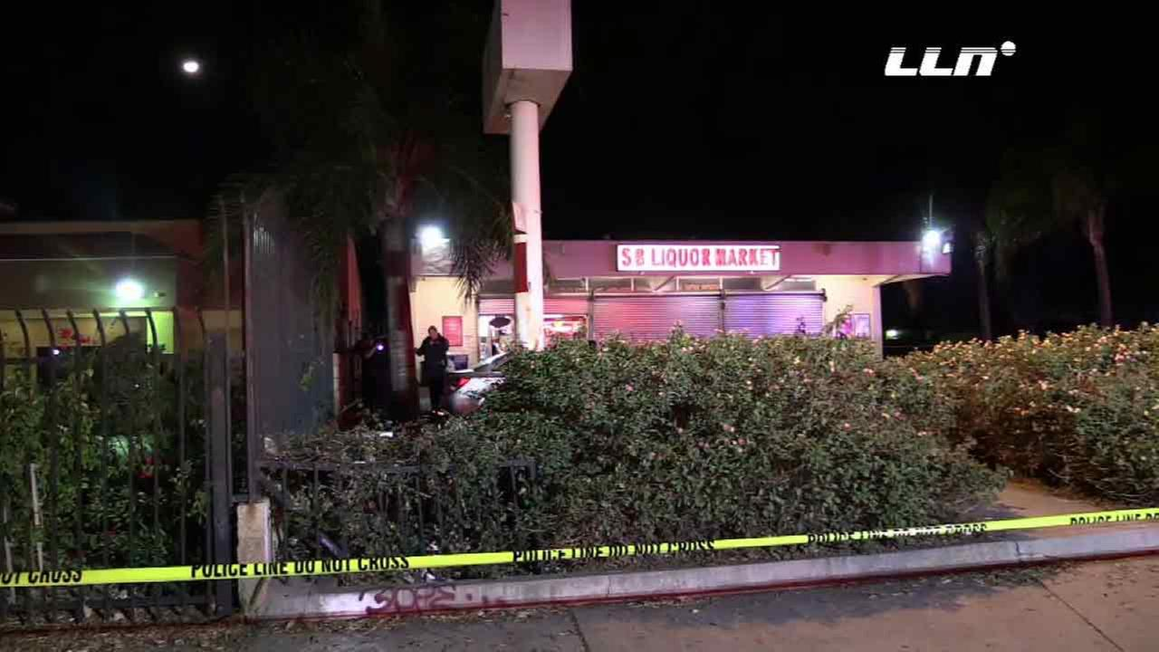 Police investigate a shooting at a liquor store in San Bernardino that left one person dead and another injured on Friday, Dec. 19, 2015.