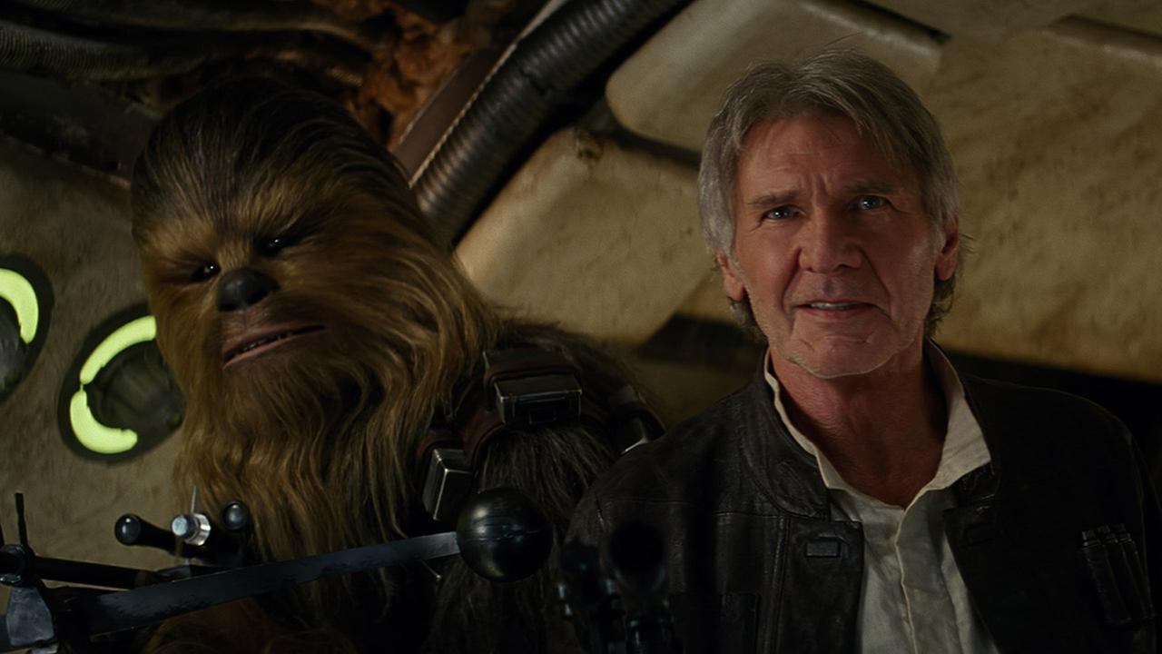 Chewbacca and Han Solo are shown in a scene from Star Wars: The Force Awakens.