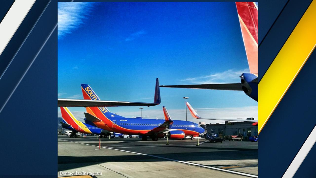 A photo posted to social media by a passenger appears to show the wings of two Southwest Airline aircraft touching at Burbanks Bob Hope Airport on Sunday, Dec. 20, 2015.