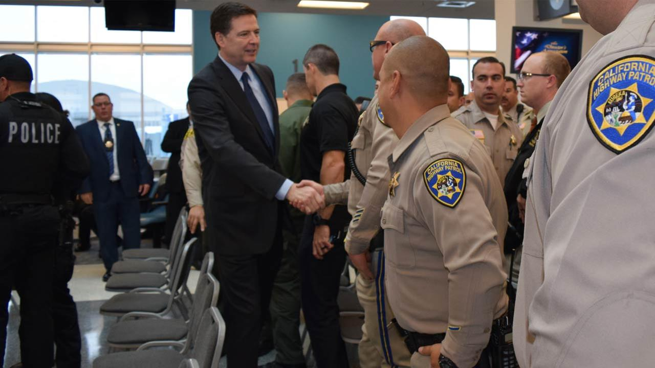 FBI Director James Comey on Tuesday, Dec. 22, 2015, shakes the hands of local first responders from the San Bernardino terror attack.