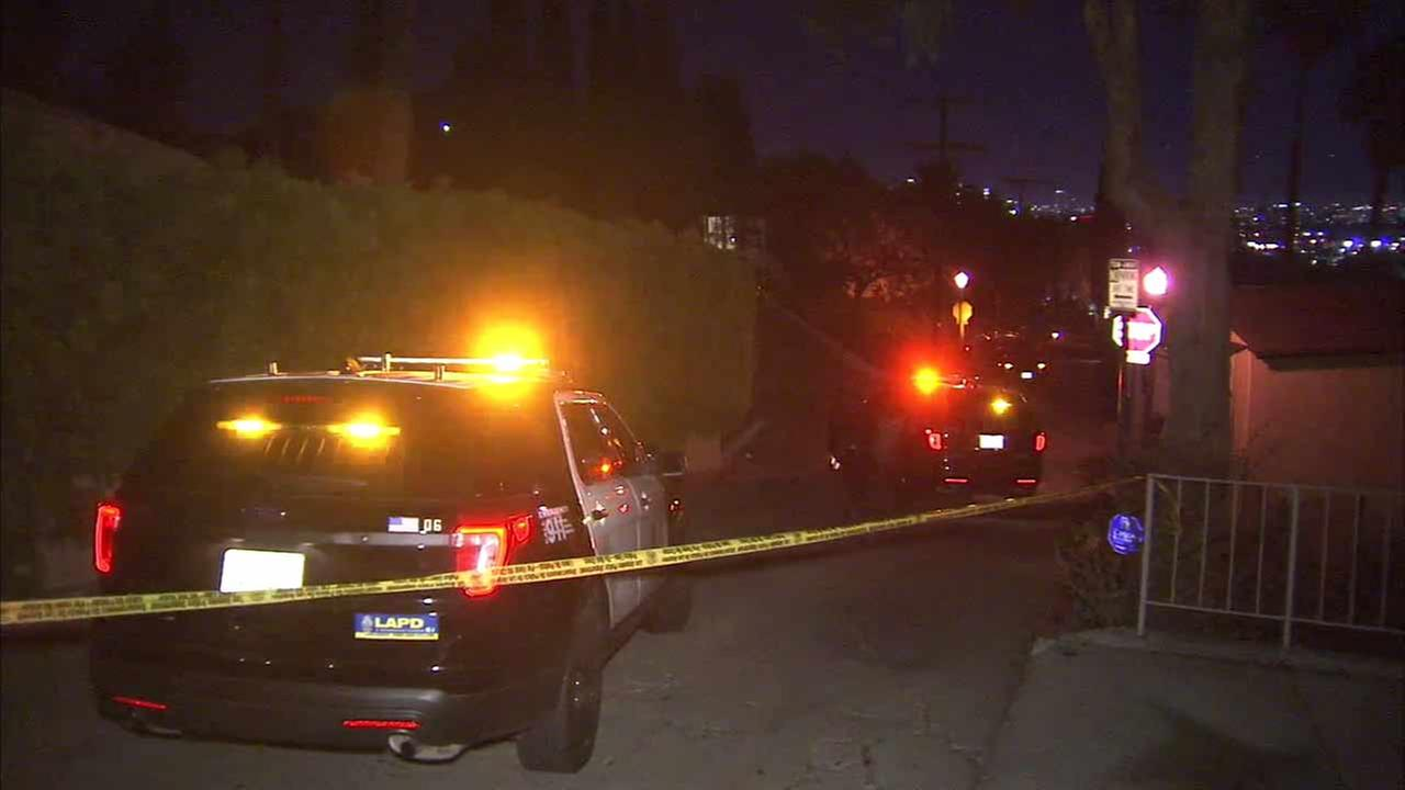 LAPD officers investigate a scene in Hollywood Hills where a man was shot and killed on Sunday, Dec. 27, 2015.