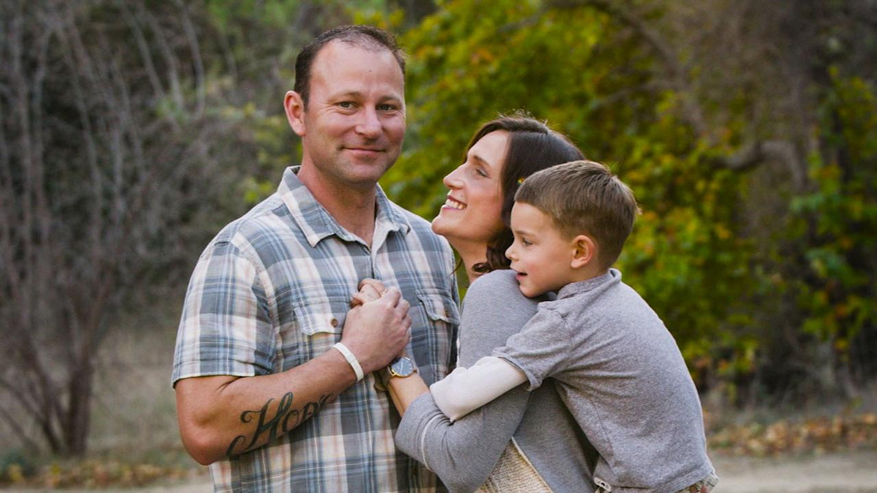 Adam Wohlstattar is seen in a photo with his wife Brinden and son Grayson.