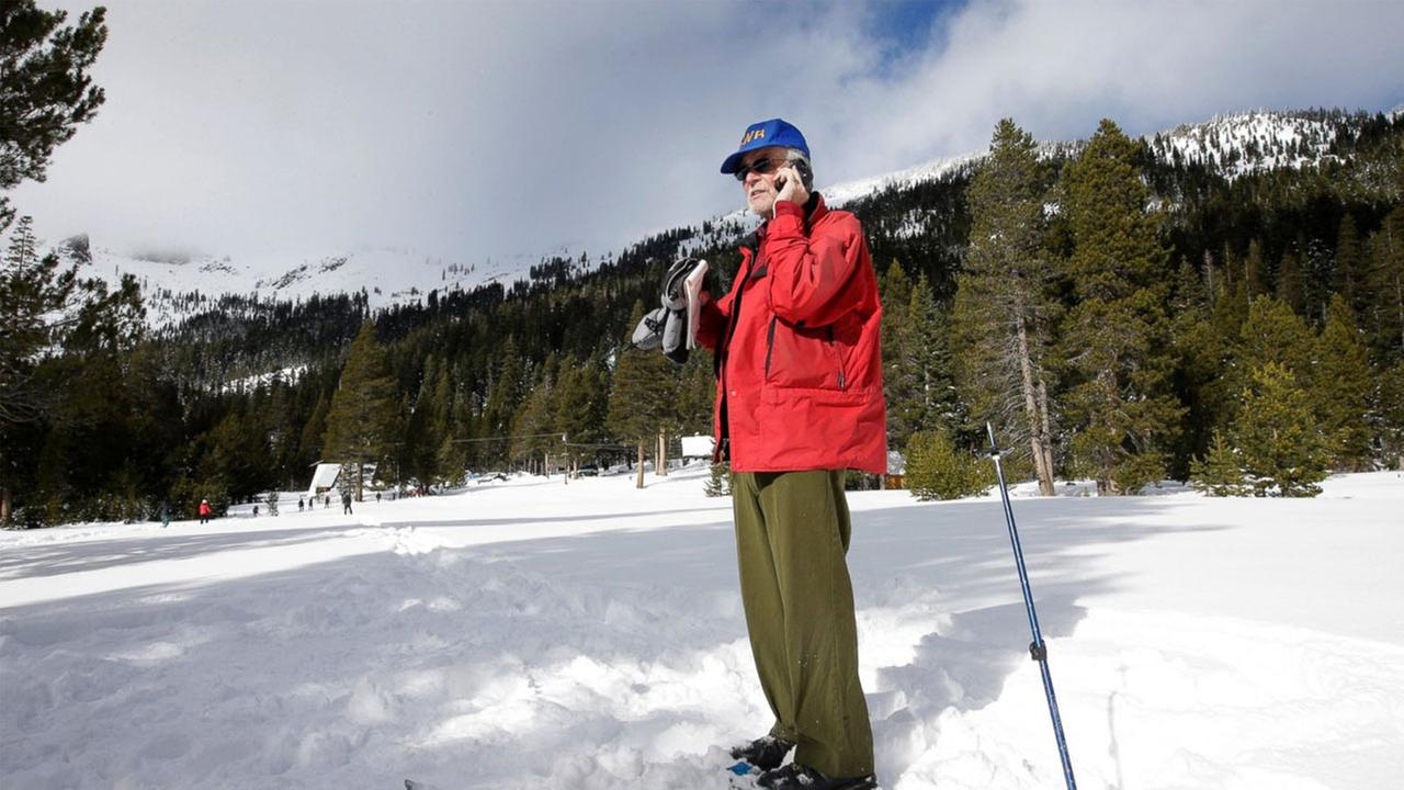 Frank Gehrke, chief of the California Cooperative Snow Surveys Program for the Department of Water Resources, does a phone interview after the first manual snow survey of the season at Phillips Station near Echo Summit, Calif., Wednesday, Dec. 30, 2015.
