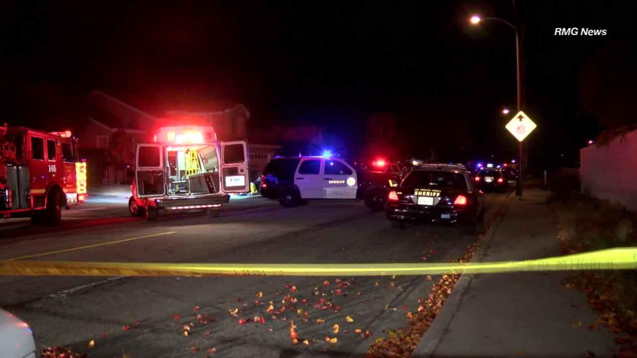 Police investigate the scene of a shooting that left four dead in Rowland Heights on New Years Eve, Dec. 31, 2015.