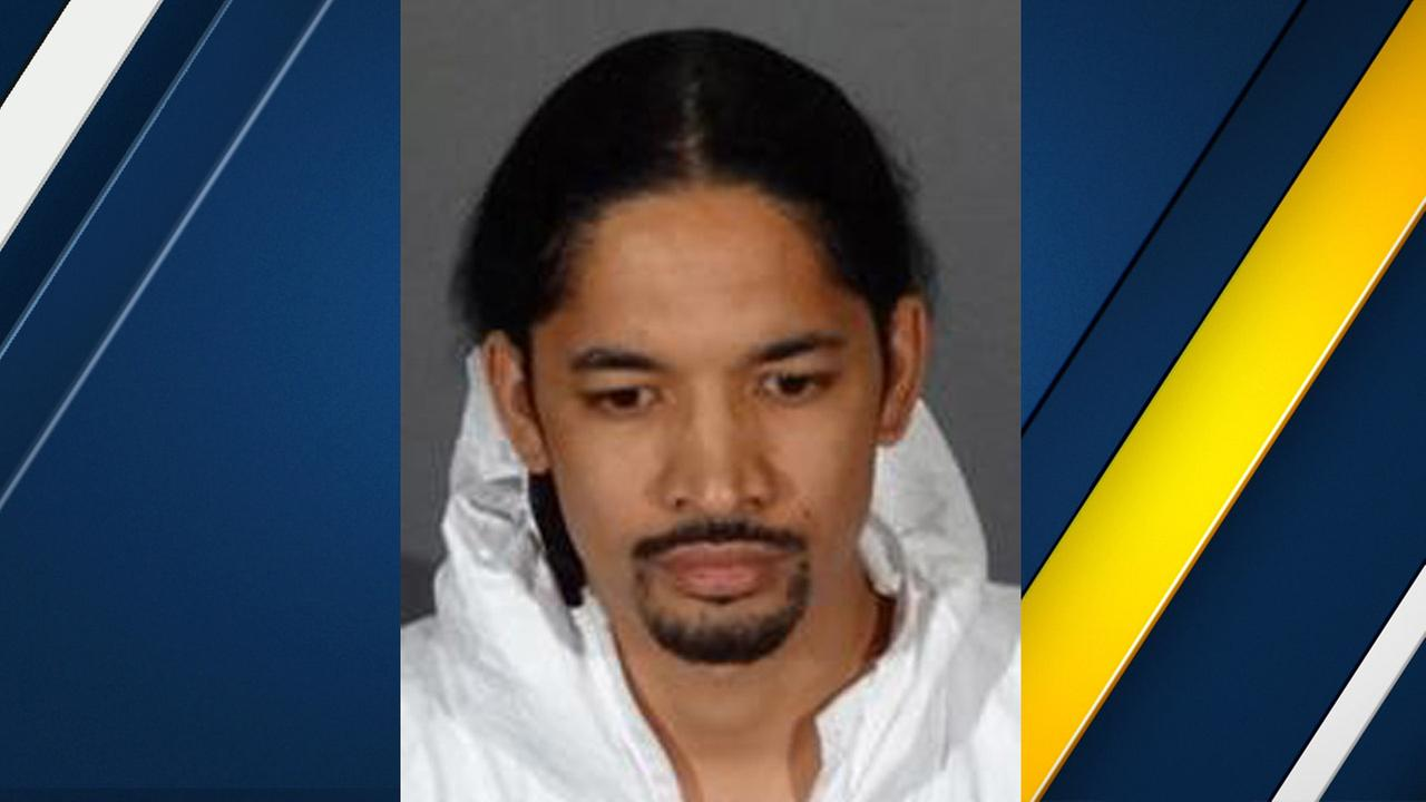 Michael Charles Parker, 31, is shown in a mugshot taken at the Covina Police Department.