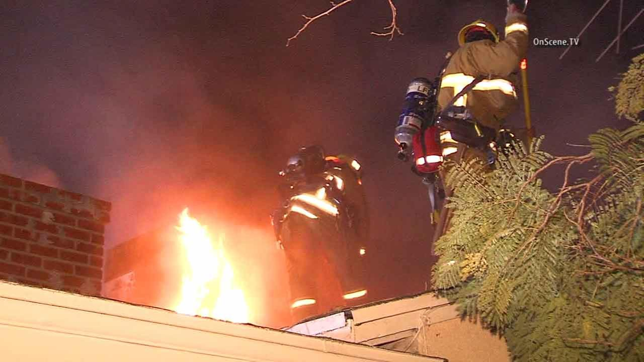 Flames shoot through the roof of a home in Van Nuys after a hoverboard caught fire on Sunday, Nov. 3, 2016.