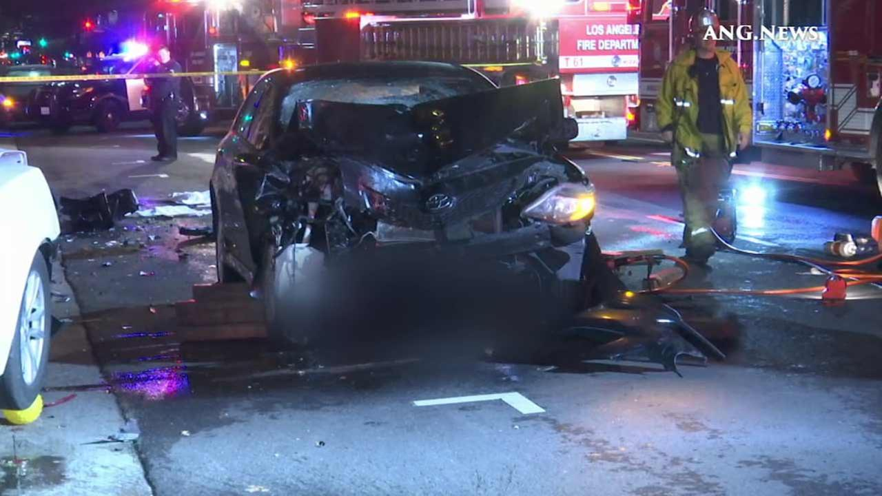 Los Angeles police investigate a fatal crash near N. Formosa Avenue and Beverly Boulevard in the Fairfax District on Wednesday, Jan. 6, 2016.
