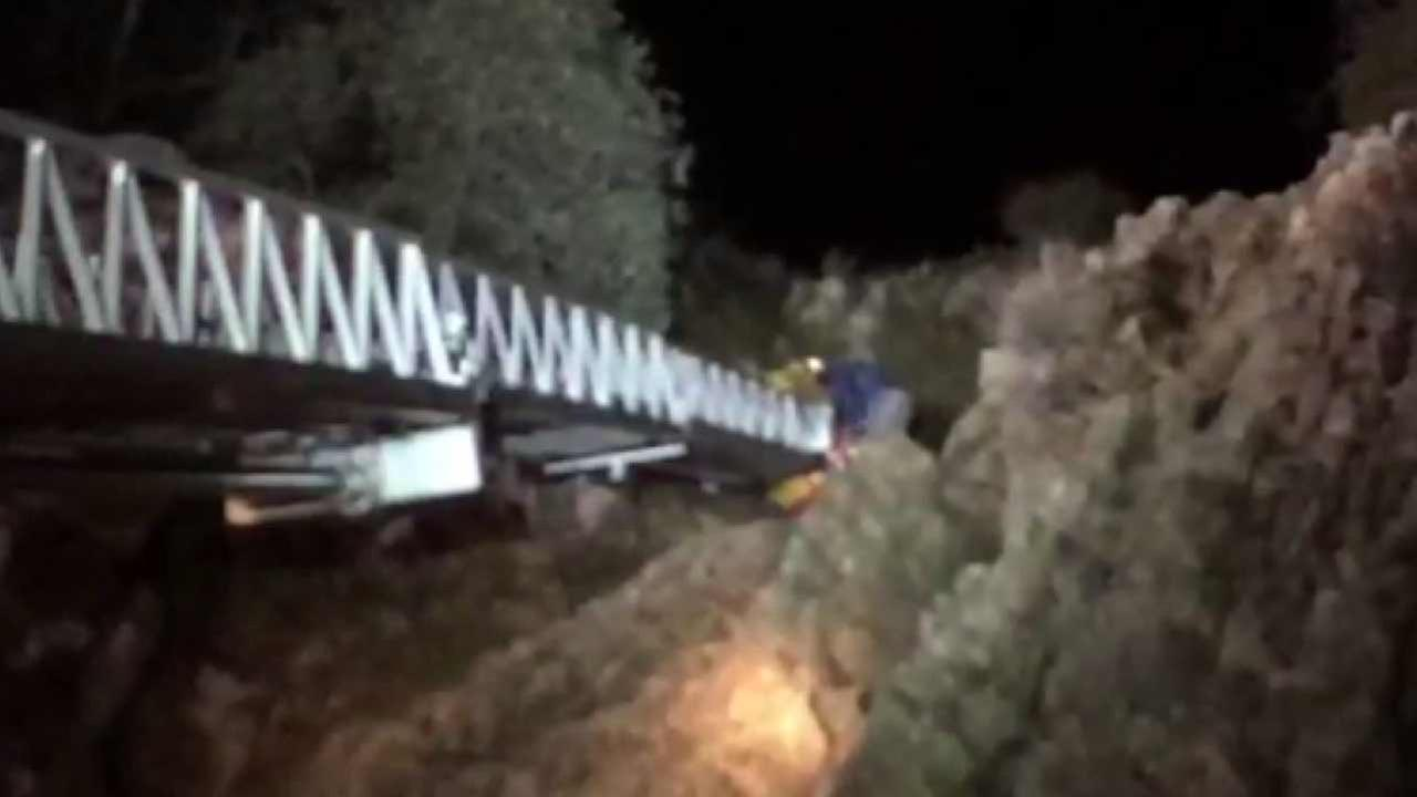 Los Angeles County firefighters used an aerial ladder to rescue a 12-year-old boy from a steep slope near Georges Gap north of La Canada Flintridge on Sunday, Jan. 10, 2016.