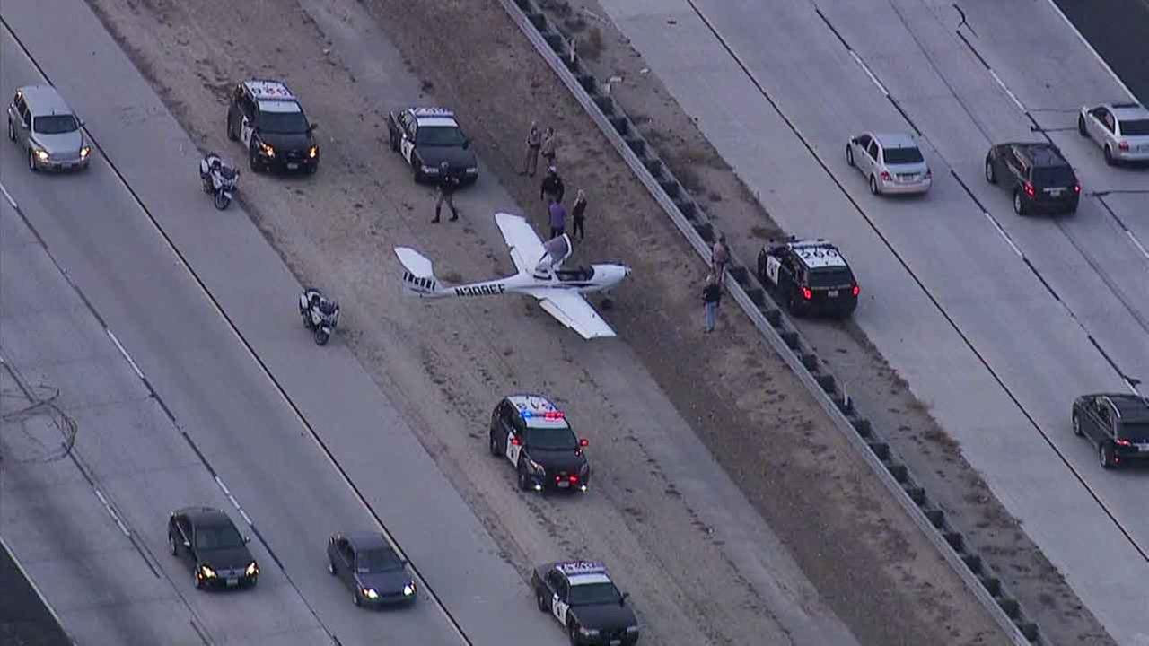 A plane makes an emergency landing on the 23 Freeway in Moorpark on Monday, Jan. 11, 2016.