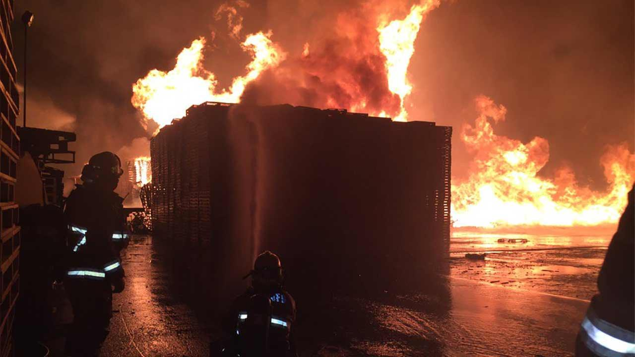 San Bernardino County firefighters respond to a 2-alarm blaze at a pallet yard near Sierra and Slover avenues in Fontana Wednesday, Jan. 13, 2016.