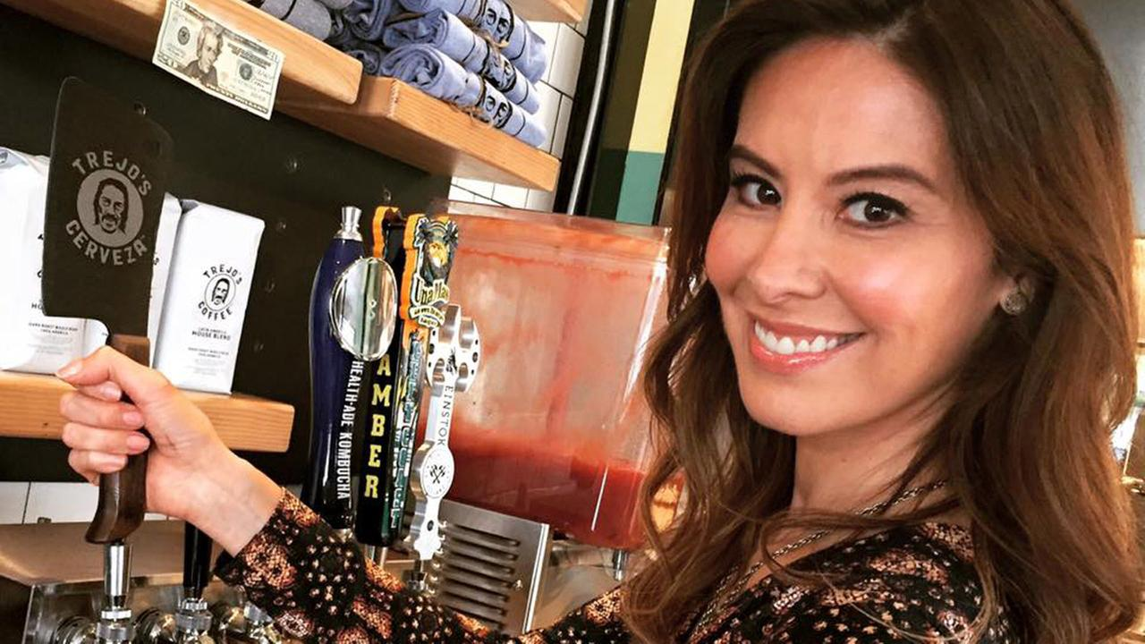 Patricia Lopez serves herself up some of Danny Trejos Trejos Cerveza at his taco shop in Los Angeles.