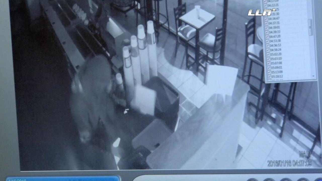 Surveillance footage shows a suspect stealing a cash register at a Subway in the San Fernando Valley.