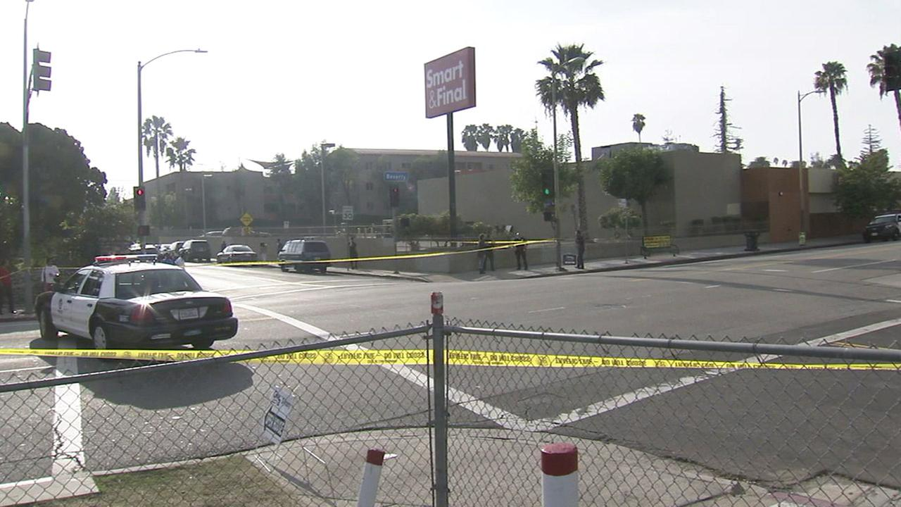 Authorities cordoned off an intersection after a man in his 20s was shot to death in the Rampart Village neighborhood on Sunday, Jan. 17, 2016.