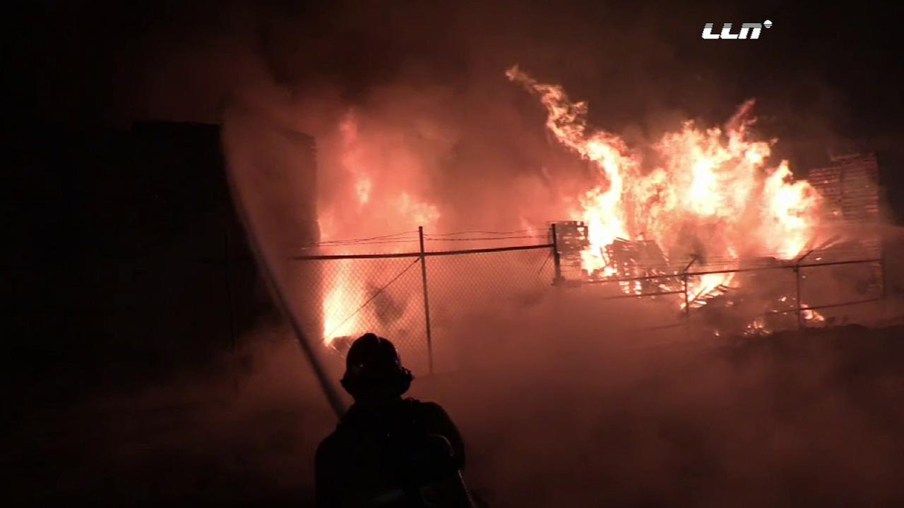 San Bernardino County firefighters respond to a fire at a pallet yard in the 15600 block of Boyle Avenue in Fontana Sunday, Jan. 17, 2016.
