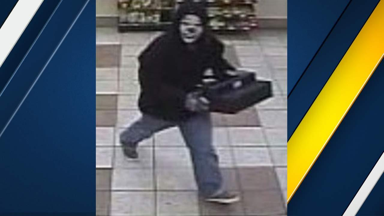 A surveillance still image shows a suspect wearing a clown mask robbing an Arco AM/PM on on Monday, Jan. 25, 2016.
