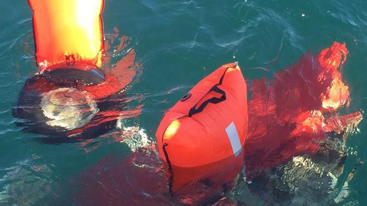An aircraft tire and other debris was recovered Sunday, Feb. 7, 2016, by dive teams searching for remains from a midair crash off the coast of San Pedro.