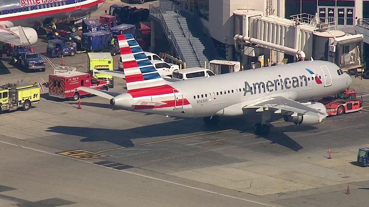 An American Airlines plane sits on the ground at Los Angeles International Airport Thursday, Feb. 11, 2016 after being diverted due to a mechanical issue.