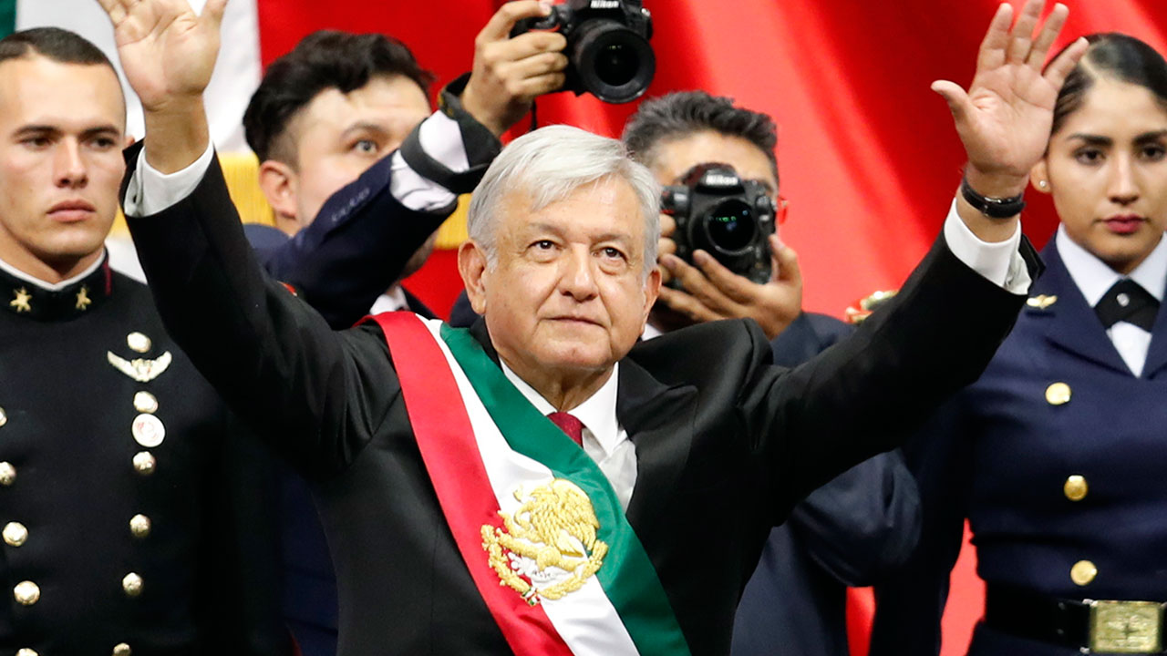 Mexicos new President Andres Manuel Lopez Obrador greets the crowd at the end of his inaugural ceremony at the National Congress in Mexico City, Saturday, Dec. 1, 2018.