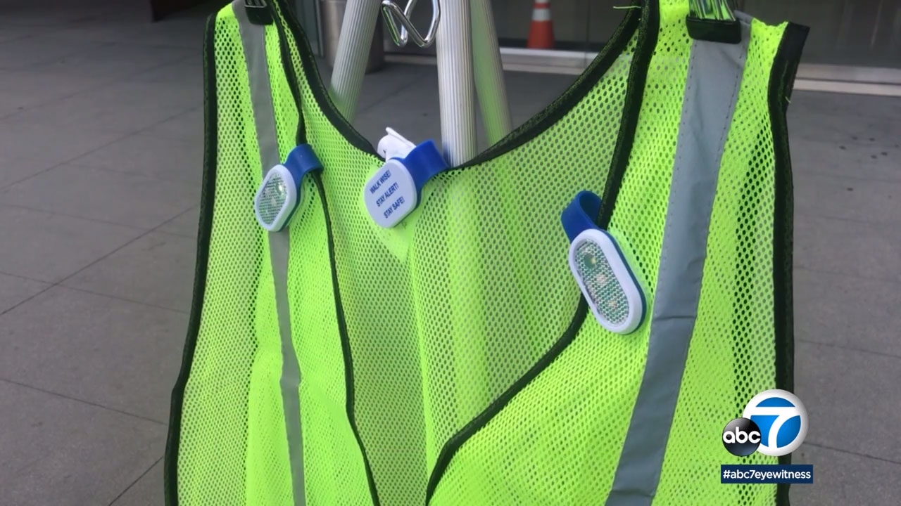 The LAPD is giving away reflective vests and lights to help improve pedestrian safety.