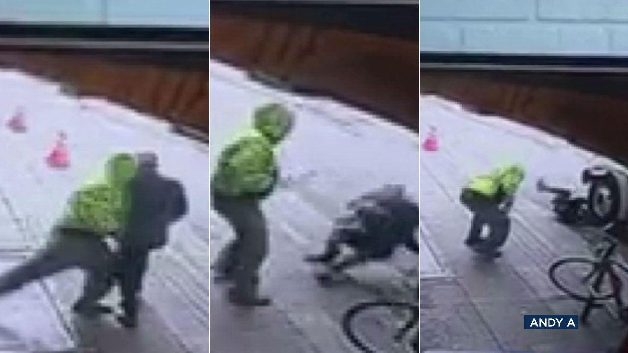 Surveillance video shows a suspect pushing a man into the street and under the wheels of a truck in a seemingly random attack in downtown Los Angeles.