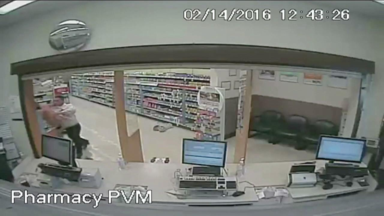 Surveillance footage captures the moment a suspect attempts to rob a Walgreens pharmacy but is confronted by a former Florida state boxing champion on Sunday, Feb. 14, 2016.