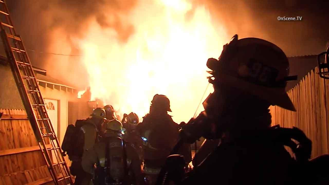 Los Angeles firefighters battle a blaze at a residence in the 200 block of Wilsey Avenue in Tujunga Thursday, Feb. 18, 2016.
