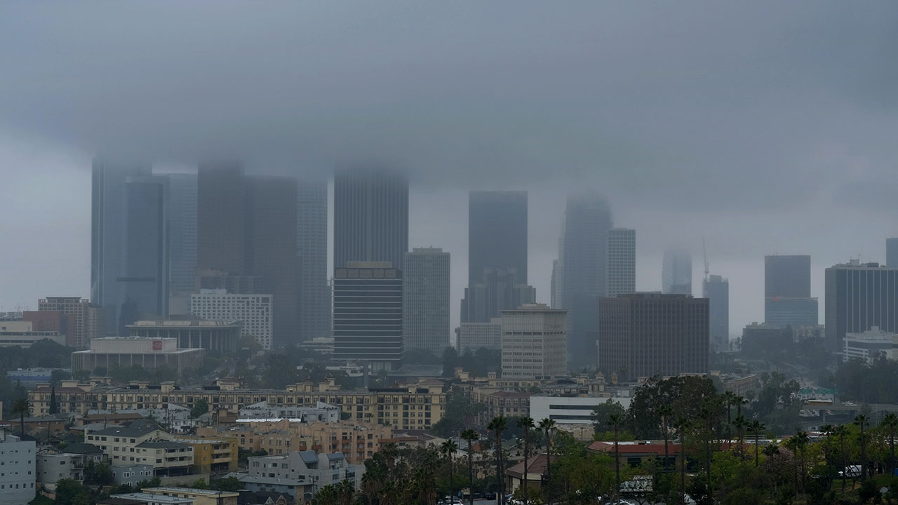 The skyline of Los Angeles is obscured by clouds as a heavy storm sweeps through Southern California.