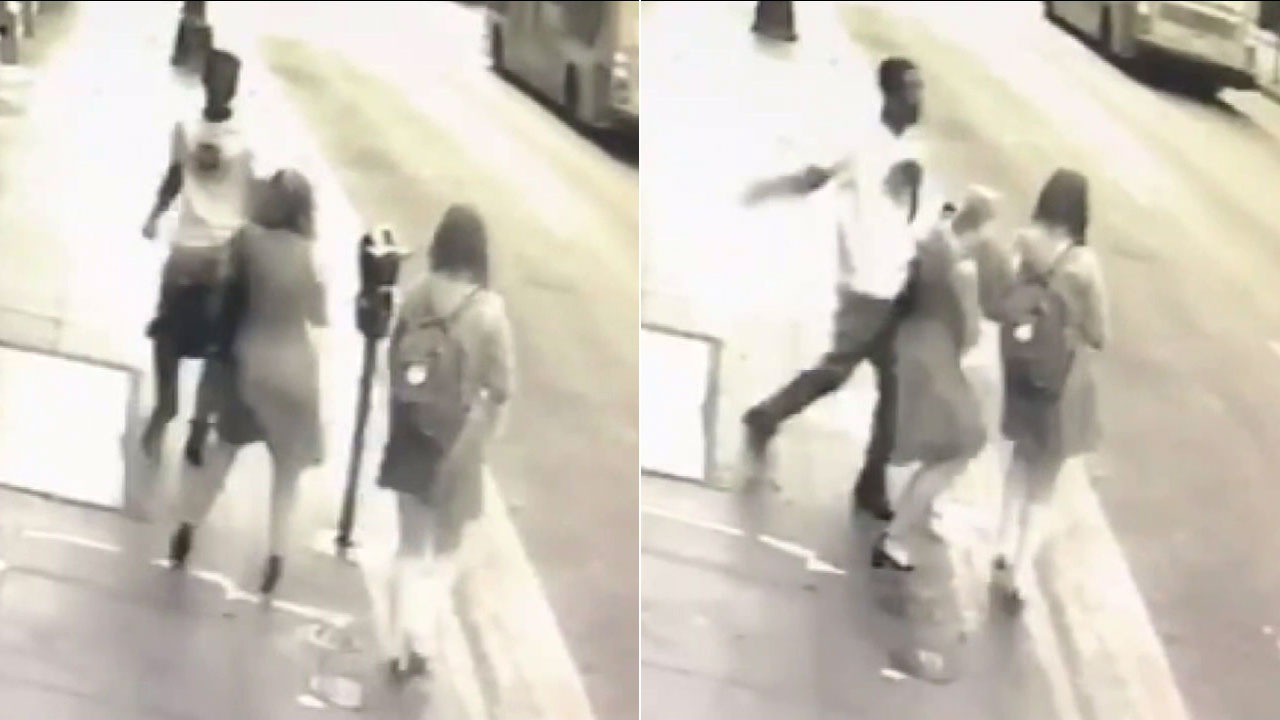 Surveillance video shows a man in downtown Los Angeles swinging at a woman and her daughter as they were walking down the street.