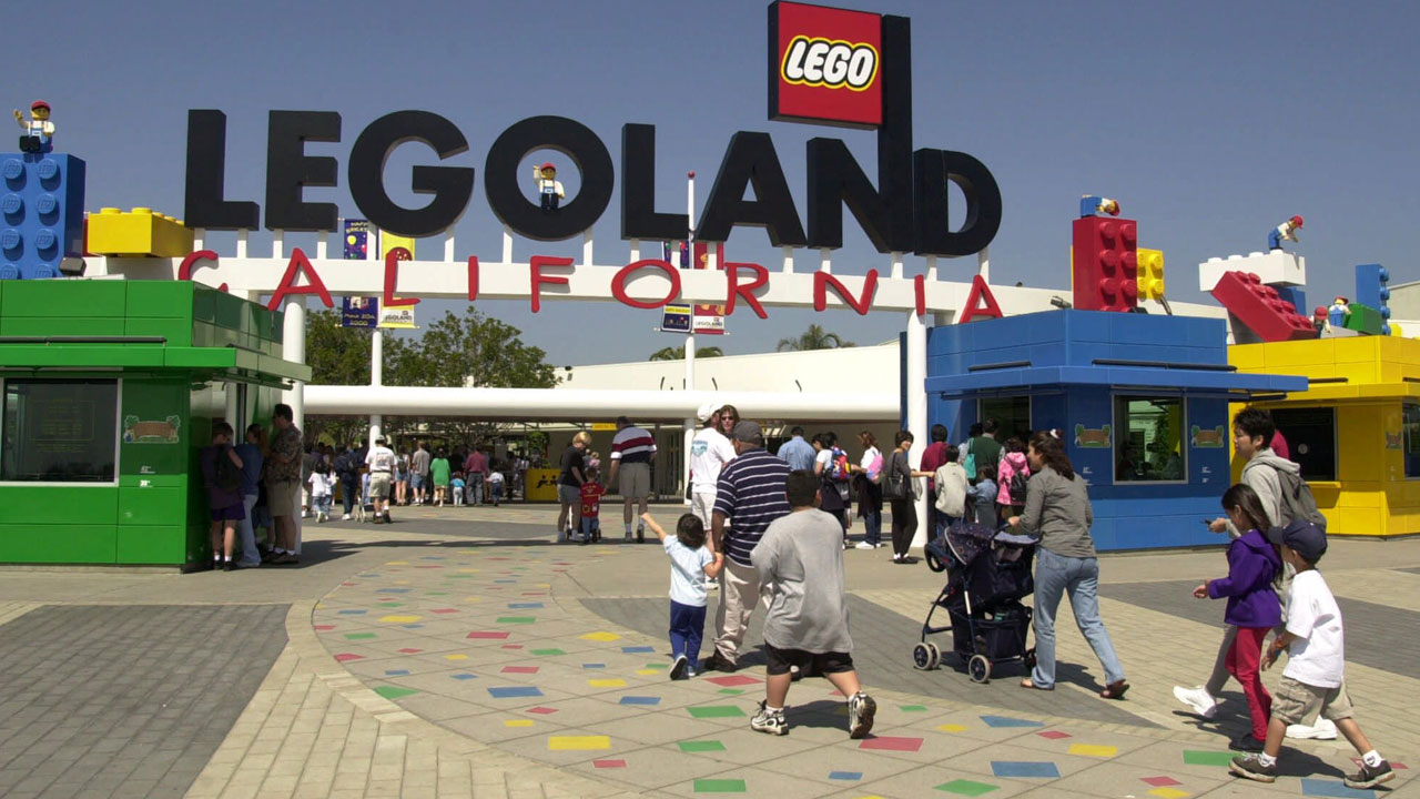 Children and parents rush to line up and buy tickets at Legoland California in Carlsbad, Calif., Saturday, March 18, 2000.