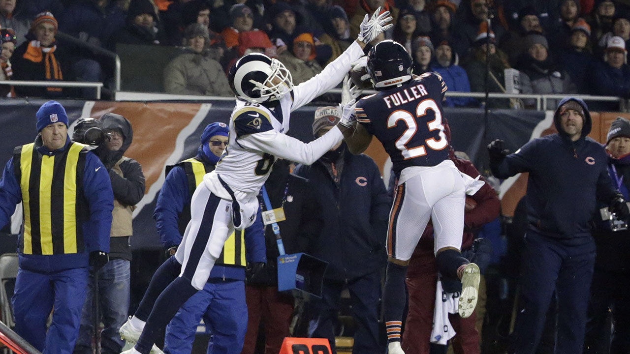 Chicago Bears cornerback Kyle Fuller (23) intercepts a pass for Los Angeles Rams wide receiver Josh Reynolds (83) during a game Sunday, Dec. 9, 2018, in Chicago.