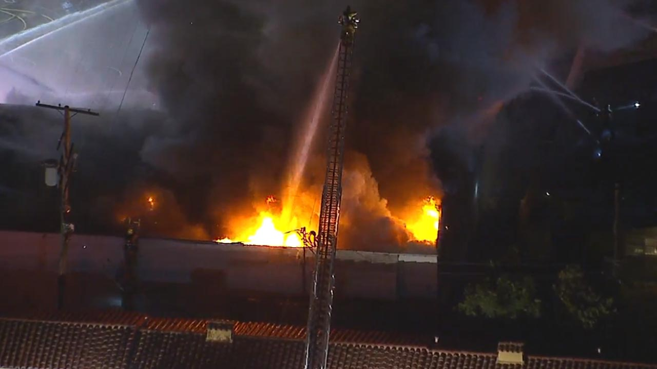 A fire tore through a structure located within a strip mall in Sylmar on Monday, Dec. 10, 2018.