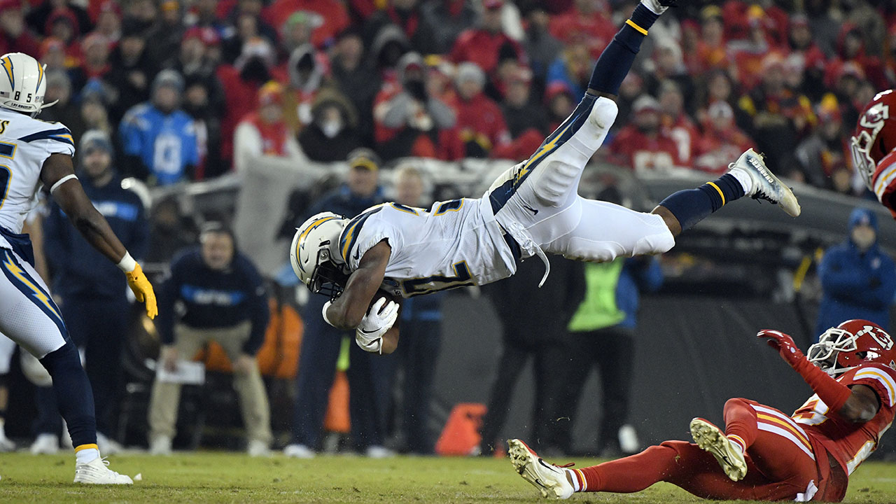 Chargers running back Justin Jackson (32) is upended after a tackle by Chiefs cornerback Kendall Fuller, right, during a game in Kansas City, Mo., Dec. 13, 2018.