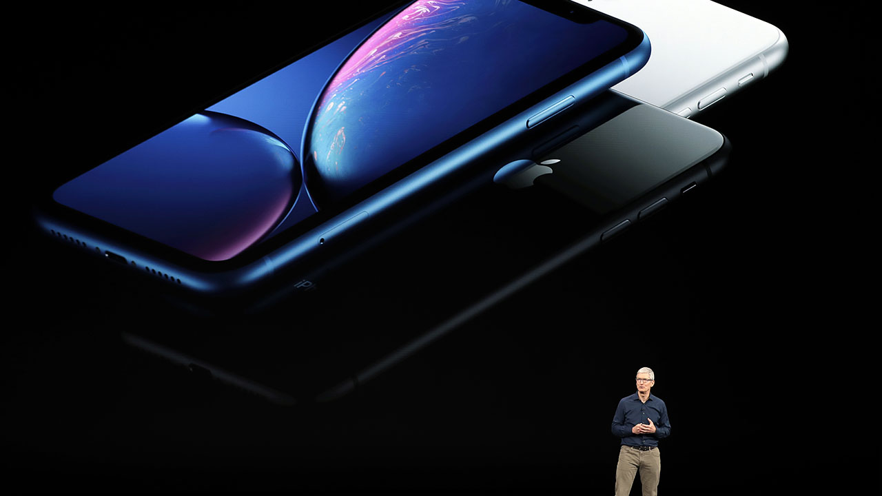 Apple CEO Tim Cook discusses the new iPhones at the Steve Jobs Theater during an event to announce new products Wednesday, Sept. 12, 2018, in Cupertino, Calif.