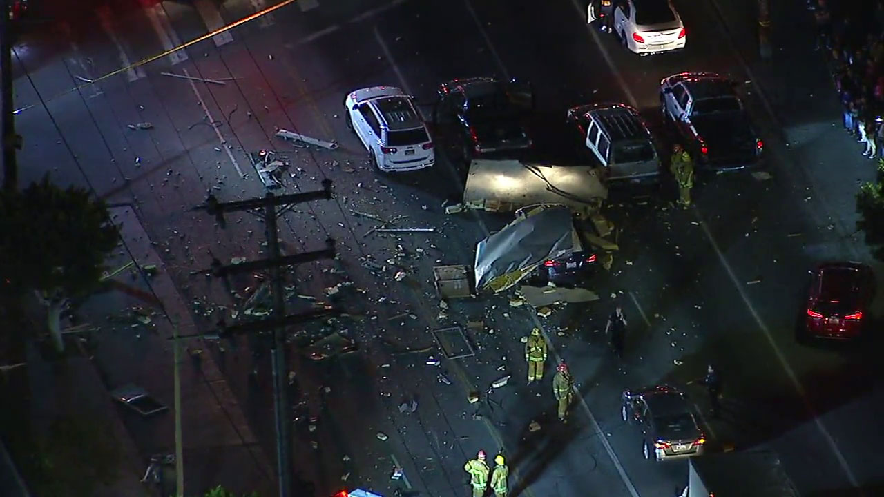 The fragments of a box truck are shown strewn all over a street in Boyle Heights after a reported explosion.