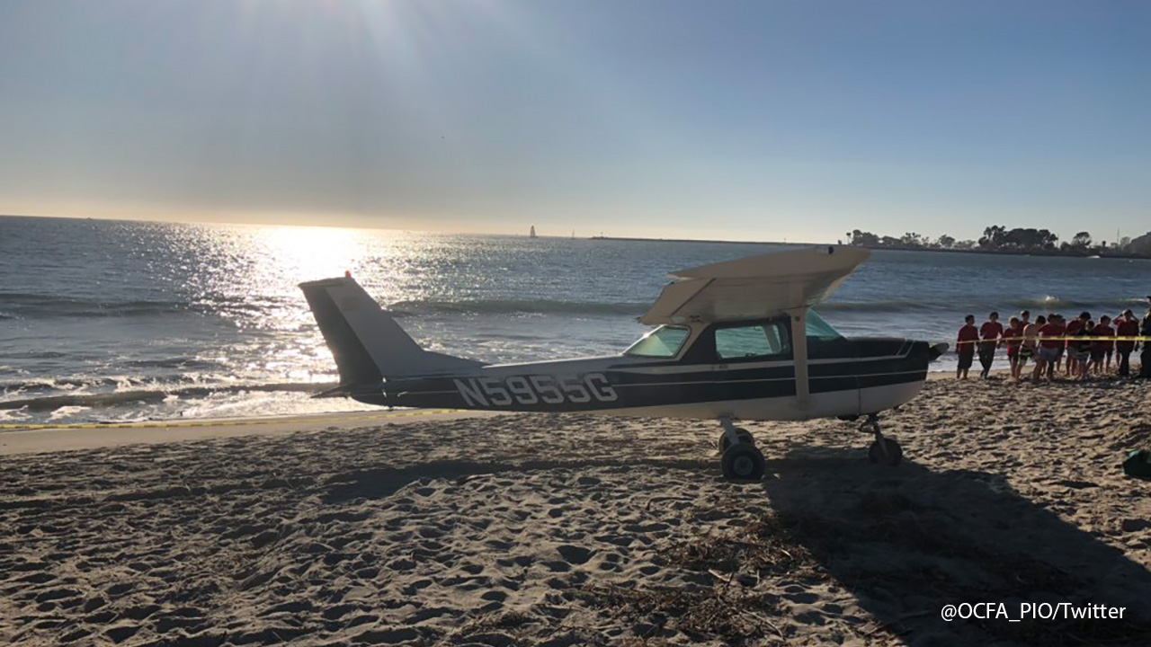 A photo from the Orange County Fire Authority shows a small plane that made an emergency landing on a beach in Dana Point on Saturday, Dec. 15, 2018.
