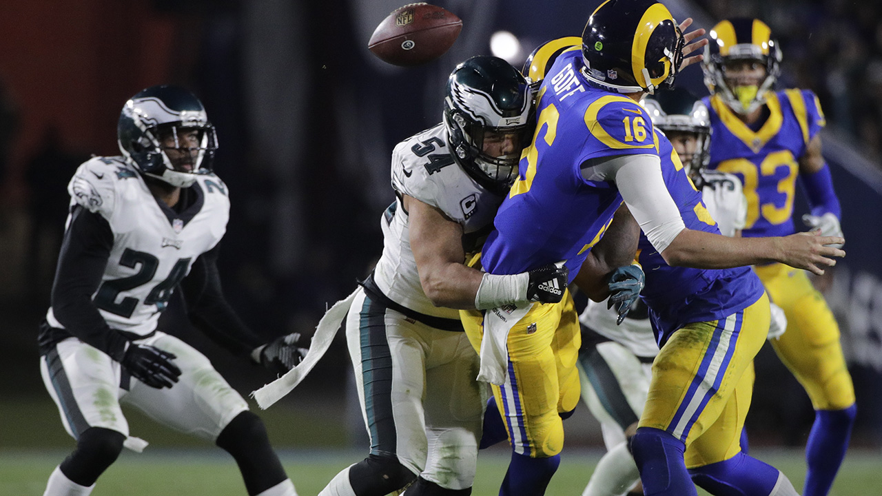 Philadelphia Eagles outside linebacker Kamu Grugier-Hill forces a fumble by Los Angeles Rams quarterback Jared Goff during the second half in an NFL football game Dec. 16, 2018.