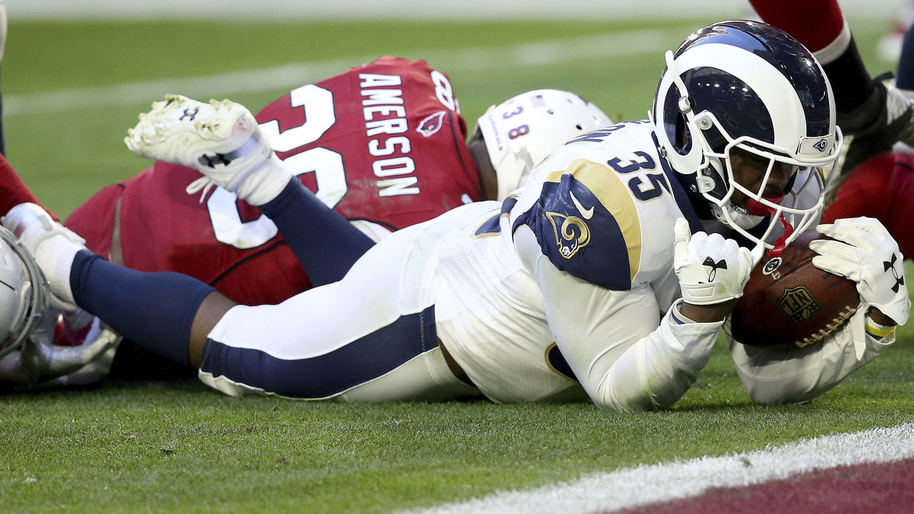 Los Angeles Rams running back C.J. Anderson falls into the end zone for a touchdown against the Arizona Cardinals during an NFL football game in Glendale, Ariz.