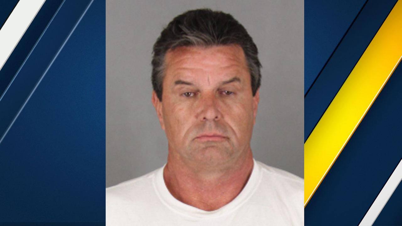 Brady Loser is shown in a booking photo.