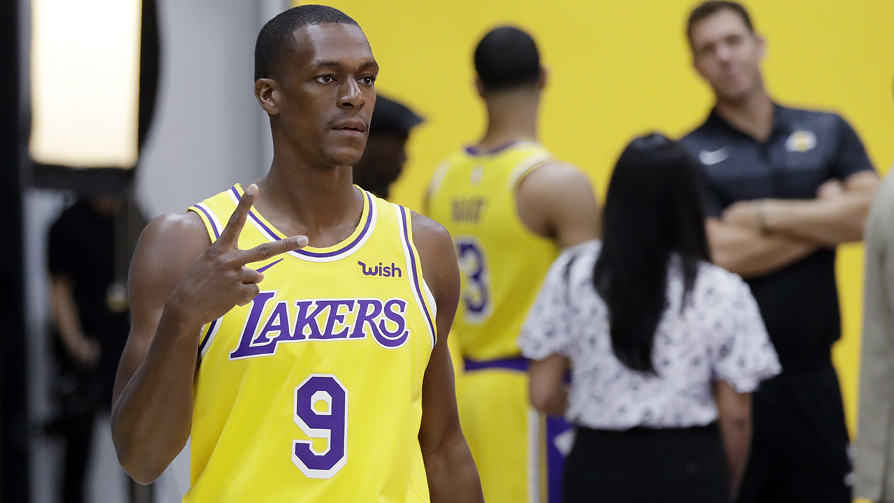 Los Angeles Lakers Rajon Rondo (9) poses for photos during media day at the NBA basketball teams practice facility Monday, Sept. 24, 2018, in El Segundo, Calif.