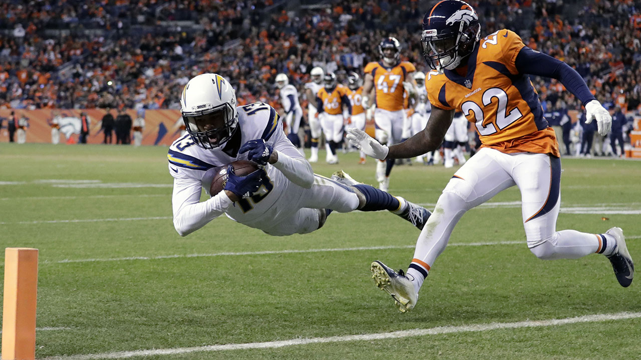 LA Chargers wide receiver Keenan Allen makes a leaping catch just outside the end zone as Broncos defensive back Tramaine Brock (22) defends on Sunday, Dec. 30, 2018, in Denver.