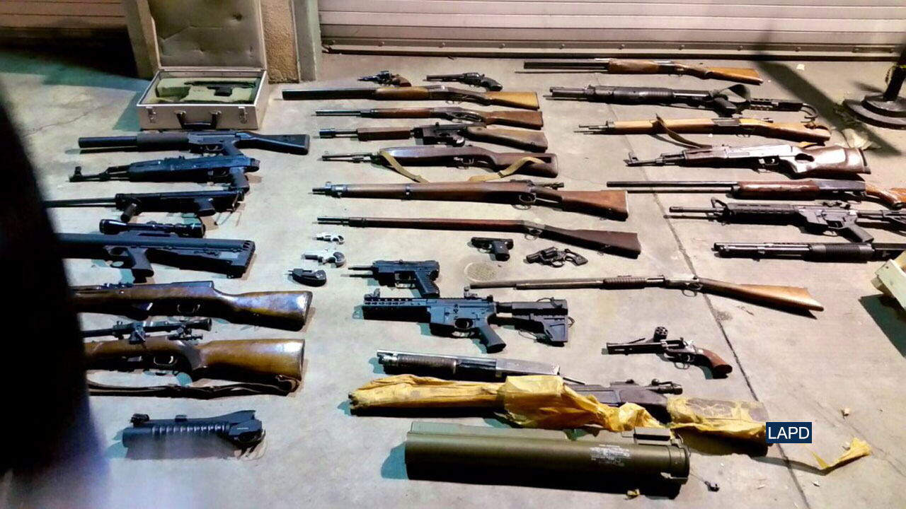 LAPD officers seized weapons from a home in South Los Angeles after a report of a man riding a motorcycle with a rifle.