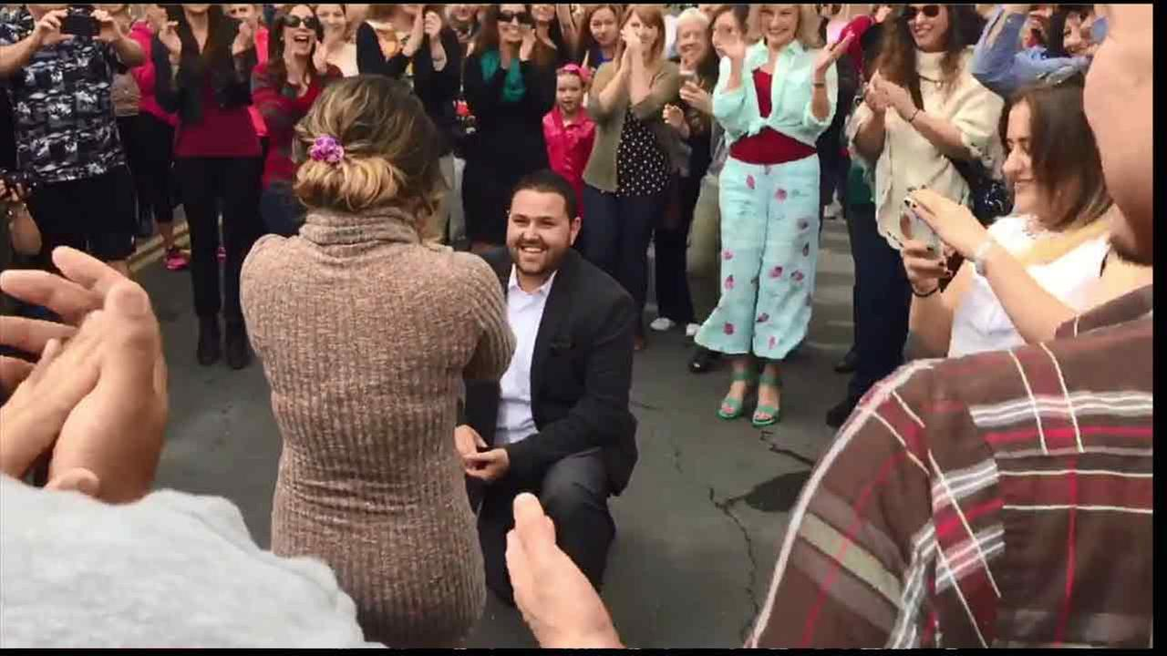 Arthur Kasabyan proposes to his girlfriend with a flash mob-style performance in Glendale, Calif. on Sunday, March, 26, 2016.