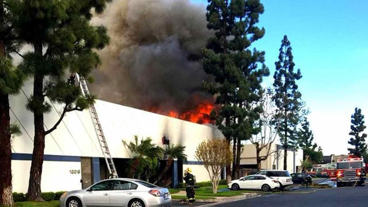 Santa Fe Springs firefighters respond to a commercial building fire in Santa Fe Springs, Calif., on Monday, March 7, 2016.