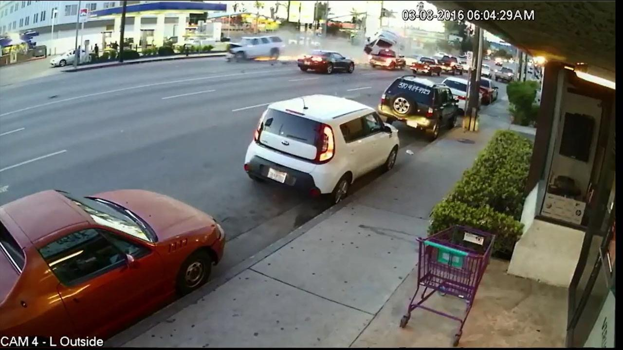 A violent multi-car crash in Van Nuys was captured on security camera footage.