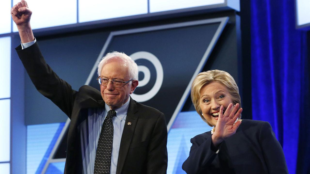 Sen. Bernie Sanders, I-Vt., and Hillary Clinton stand together before the start of the Univision, Washington Post Democratic presidential debate Wednesday, March 9, 2016, in Miami.