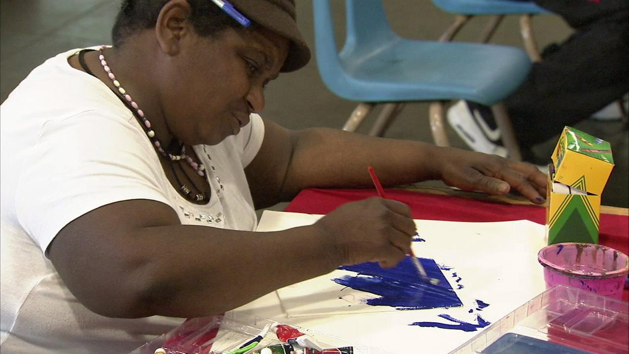 With concentration and a steady hand, a participant in the Midnight Missions Art with a Mission program creates her masterpiece.