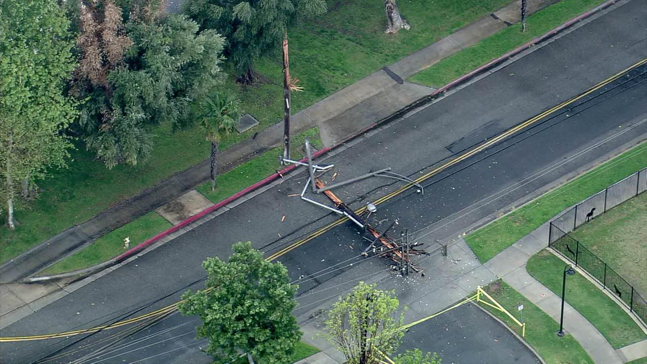 A downed utility pole blocks a roadway in Riverside on Friday, March 11, 2016.